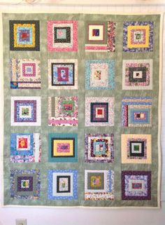 """a flannel quilt:  The blocks are 8"""" with a 2"""" border. I hardly measured, just started adding strips then trimmed to 8"""". It was a fun and easy way to use up a lot of random material."""