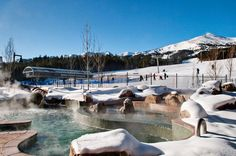 The Outdoor Jacuzzi at The Grand Lodge on Peak 7 with view of the Ski Runs in Breckenridge, Colorado.