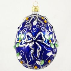 This beautiful blue ornament with white ribbon, and yellow crystals is another in the egg series. This truly ornately designed egg, which symbolizes new life, is a wonderful adornment for a Christmas