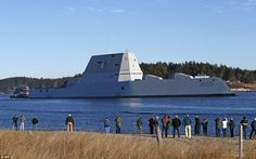 On its way: The U.S. Navy's first Zumwalt-class destroyer leaves the Kennebec River in Maine on Monday morning - passing a crowd of spectators - as it heads out to sea for the first time to undergo sea trials