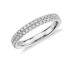 Double the brilliance! This diamond band holds two rows of pave-set diamonds, all set in 14k white gold