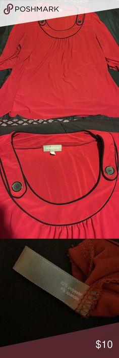Essentials size 22/24 top with 3/4 sleeves. Cute buttons at the neckline. 3/4 sleeves 92% polyester 8% spandex Essentials Tops Blouses