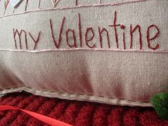 This valentine-themed hand-made muslin needlework pillow is perfect for Valentines Day and for that special someone in your life! Size is approximately 16 x 8.