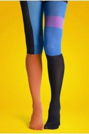 Tights crafted in nylon, featuring asymmetric block color detail to the main, chic and modern, in a soft and stretch finish, with a form fitting design.