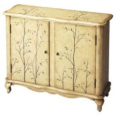 "Hand-painted chest with a tree motif and 2 doors.  Product: ChestConstruction Material: Poplar and MDFColor: IvoryFeatures:  Hand-paintedTwo doors Dimensions: 36"" H x 12"" W x 32"" D"