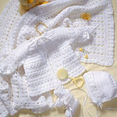 Crochet Pattern Sweaters Lacey Layette Free Pattern - These baby set crochet patterns are so cute! If I had all the time in the world I would make every one. These baby sets are perfect for a baby shower gift! Crochet Baby Sweaters, Crochet Baby Bonnet, Baby Girl Crochet, Crochet Baby Clothes, Newborn Crochet, Baby Blanket Crochet, Baby Knitting, Crochet Cardigan, Crochet Baby Cardigan Free Pattern