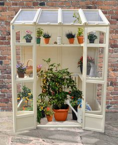The Hartwood Victorian Tall Wall Greenhouse is flexible and compact. The Greenhouse includes two heights of shelving and the middle shelves can be adjusted to accommodate any taller plants. The greenhouse has two opening vents suitable for use with aut Build A Greenhouse, Indoor Greenhouse, Greenhouse Gardening, Greenhouse Ideas, Greenhouse Wedding, Cheap Greenhouse, Old Window Greenhouse, Homemade Greenhouse, Portable Greenhouse