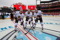 Patrick Kane, Artem Anisimov and Artemi Panarin pose for a photo at Busch Stadium. #2017WinterClassic