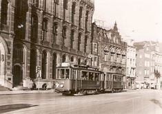 1950's. A view of the Nieuwezijds Voorburgwal with tram line 13 in Amsterdam. The Nieuwezijds Voorburgwal is a wide and busy street that connects the Spui with the Martelaarsgracht. The street runs parallel to the Spuistraat. The Raadhuisstraat runs from the Nieuwezijds Voorburgwal in western direction. On the east-side there are a number of small alleys that give access to the Kalverstraat.. Photo Jeroen Epema #amsterdam #1950 #NieuwezijdsVoorburgwal