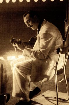 "Django Reinhardt- the great gypsy jazz guitarist. First brought to my attention in the early '90's in the movie, ""Swing Kids""."