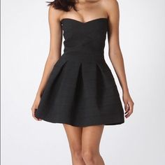 Wow Couture strapless fit & flare bandage dress Stretchy, sturdy black bandage dress. A-line fit & flare style. Very flattering. WOW couture Dresses Strapless