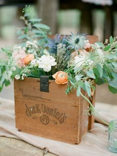 15 Rustic Wedding Centerpieces Photo by Sawyer Baird. I like the box but not so much the flowers.