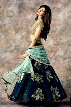 Stunning peacock blue color designer lehenga and gold sequence blouse with ice blue color net dupatta. Indian Bridal Outfits, Indian Bridal Lehenga, Indian Gowns, Indian Designer Outfits, Lehenga Choli Wedding, Choli Designs, Lehenga Designs, Designer Bridal Lehenga, Designer Lehanga