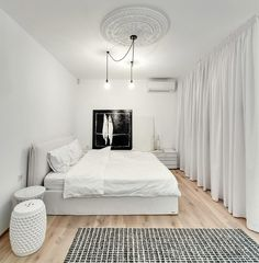 This white apartment in Kiev makes a strong case for monochromatic design. Regardless of practicality, an almost entirely white apartment looks fantastic. White Wall Bedroom, Bedroom Red, White Bedroom Furniture, Bedroom Decor, Bedroom Modern, Red Bedroom Design, Decoracion Vintage Chic, Rustic Bathroom Designs, White Apartment