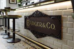 Tiled bar front interior design. Badger & Co. Edinburgh. By Tibbatts Abel - Award Winning Interior Designers. www.tibbattsabel.com.  Metro Tiles. Tiled Counter Front. Brass footrail.