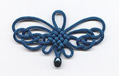 Butterfly Knot (http://www.chineseknots.com/Classic.html).  This is a variation using panchang knot. Butterfly knot can be also made with brocade as the center knot.