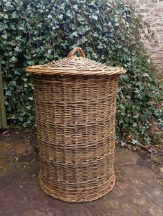 Upright round linen basket by John Cowan Baskets