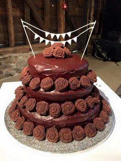 Three tier chocolate wedding cake with truffle roses