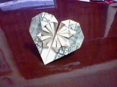 This kind of love comes cheap! Free tutorial with pictures on how to fold an origami shape in under 7 minutes by paper folding and paper folding with money. Inspired by shapes, hearts, and hearts. How To posted by Rewrite. Folding Money, Origami Folding, Paper Folding, Money Origami Heart, Oragami Money, Money Lei, Origami Shapes, Origami Fish, Origami Patterns