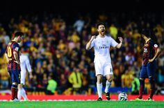 Xabi Alonso of Real Madrid CF celebrates past Lionel Messi (L) and Neymar of FC Barcelona'aftyer his teammate Gareth Bale of Real Madrid CF scored the winning goal during the Copa del Rey Final between Real Madrid and FC Barcelona at Estadio Mestalla on April 16, 2014 in Valencia, Spain.