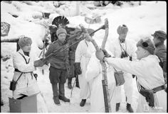 Finnish soldiers lobbing hand grenades at the Russians with a slingshot