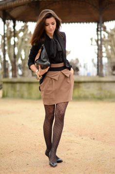 Love the bow blouse, sheer/heart tights, and enormous clutch.