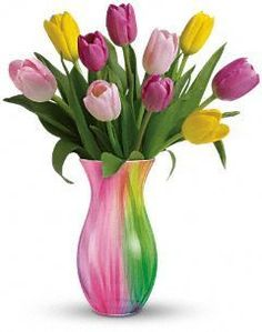 """Spring Rainbow Bouquet      Bring spring indoors with tulips in luscious shades, beautifully arranged in a dazzling glass vase graced with a rainbow of colours. It's a charming greeting for friends and a lovely celebration of spring.        The bright spring bouquet includes a mixture of spring coloured tulips.      Delivered in a glass vase decorated with bands of bright colors.      Approximately 13 1/2"""" W x 15 1/2"""" H."""