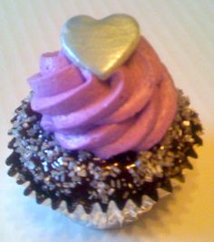 Chocolate cupcake dipped in chocolate ganache topped with a whipped marshmallow frosting.