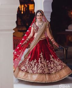 "Check out look 2 as we pick some the ""Red Bride"" looks we're digging - here's that deep deep red lehenga. Love how the cream dupatta which adds a dash of modern to a traditional look. Shot by by Indian Bridal Outfits, Indian Bridal Fashion, Indian Bridal Wear, Indian Dresses, Bridal Dresses, Indian Clothes, Lehenga Sari, Bridal Lehenga Choli, Indian Lehenga"