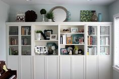 IKEA Billy bookcases, customised to look like built-in. Would look great in my dining room