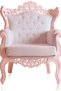 GORGEOUS chair. LOVE the scrollwork and color