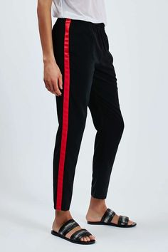 Does anybody make pants like these womens pants with a red stripe for men?  They