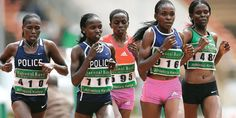 Race winner Vivian Cheruiyot (second left), the double world champion in the and metres, stays in touch with the elite pack during the Olympic trials at Kasarani on June Photo/MOHAMMED AMIN Olympic Trials, Police Officer, Athletics, Olympics, Champion, June, Touch
