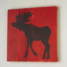 "24x24 Black Moose on Red Wood Wall PaintingWooden planks make the perfect canvas for rustic silhouettes. This moose wall art, handpainted in black on weathered red, has a vintage look. Hanging hardware included. Due to the nature of reclaimed wood, plank sizes will vary but wall art will be close to the indicated final size. (24""x24""x.75""D""x1.5""D) Made in America."