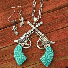 Turquoise and Rhinestone Cross Pistol Necklace Set 16.99 http://dumbblondeboutique.com/tuandrhcrpin.html