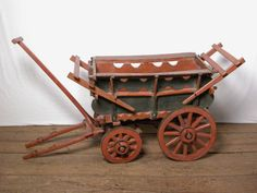 """Elaborate Suffolk style wooden farm cart with fore and aft tail boards, double shaft. model of a Suffolk wagon, c.1830"""