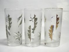 """Vintage Tumblers Gold Silver Set 3 Leaf Frosted Drinking Glass Glassware Libbey  Here's a set of three (3) vintage tumblers or water glasses that feature pretty gold and silver leaves on a frosted background. Foliage leaf design set by Libby from the mid '50s. There are two silver and one gold.  Glasses measure 5 1/2"""" inches tall x 2 3/4"""" inches in diameter with a 12 oz capacity.  Available from http://stores.ebay.com/The-Vintage-Kitchenette 3 for $3.99"""