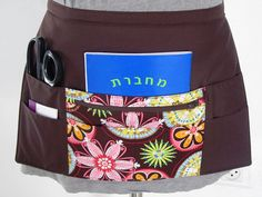 Craft vendor teacher half apron, via Flickr.