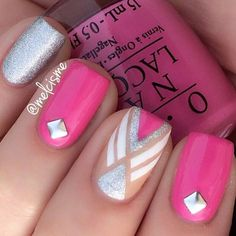 A modern looking pink nail art design. This design uses pink, white and silver glitter polishes for the detail shapes. A silver bead is also added as accent on top.