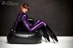 women's purple suit, woman in purple spandex long-sleeved suit and black patent leather stiletto boots sits on black leather sofa HD wallpaper Ballet Boots, Ballet Heels, Latex Wear, Latex Corset, Alexandra Potter, Latex Pants, Latex Hood, Purple Suits, French Maid