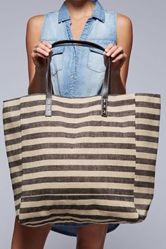Natural Jute Striped Shoulder Bag Wide shaped striped jute shoulder bag with faux leather straps. - 60% Jute, 40% Polyester - Bottom = 20inches x 8inches, Height = 15 inches, Top Opening = 23 inches