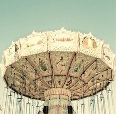 i was riding a carousel in a park in paris x