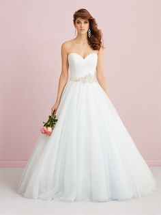 This Allure ballgown has the picture perfect princess look with a beautiful beaded belt and sparkly tulle skirt.
