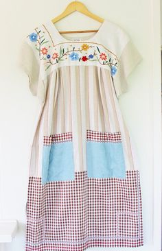 This is our new Glory Box Dress.The perfect dress to see you through Spring and Summer. A traditional Mexican style with stacks of vintage charm. Made from a co-ordinated combination of repurposed vintage linens and cloths and teamed with 100% natural linen.All cottons and linens being the fabrics used, it will keep you cool when the temperature soars.All dresses are handmade and not repeated. Each one having its own personality. The yoke is fully lined and handstitched as are the…