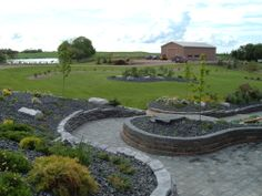 Lakeside Cottages and Country Homes by Creative Landscape & Design. A hill side is a landscape opportunity.