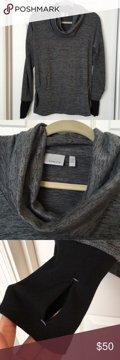 Athleta cowneck sweater Smoke and pet free! Athleta cowneck grey with black arm hole detail. Has a kangaroo pouch and thumb holes for extra comfort!! I'm 5'2 and wore it more as a tunic style with leggings! Athleta Sweaters