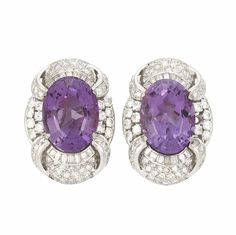 Pair of White Gold, Amethyst and Diamond Earclips, 2 oval amethysts ap. 25.35 cts., 132 round & single-cut & 28 baguette diamonds ap. 4.00 cts., ap. 15 dwts.