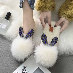Oh-so-glam! Our Jewel Embellished Pom Pom Slippers showcase a faux fur pom pom and gem-laden bunny ears. Perfect for giving your tootsies the royal treatment after a long day Pom Pom Slippers, Cute Slippers, Bunny Slippers, Apollo Box, Bedroom Slippers, Winter Slippers, Faux Fur Pom Pom, Womens Slippers, Crochet Slippers