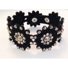 Bracciale in tessuto nero con fiori e strass argento