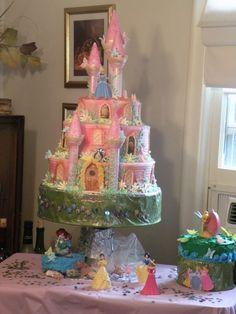 Three tiered, buttercream icing, fondant butterflies and flowers. Wilton castle kit.  Disney princesses.